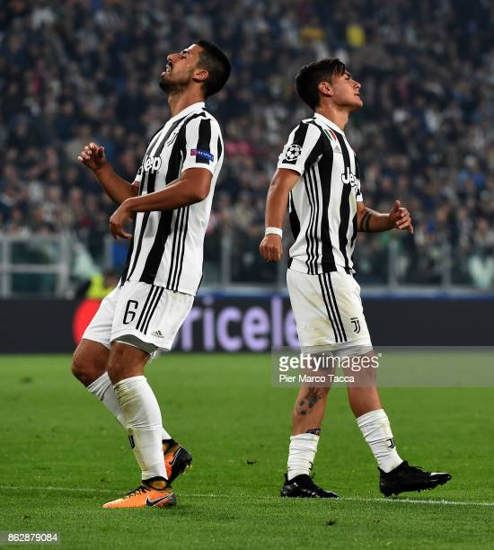 Sami Khedira and Paulo Dybala look disappointed during the UEFA Champions League group D match between Juventus and Sporting CP at Juventus Stadium...