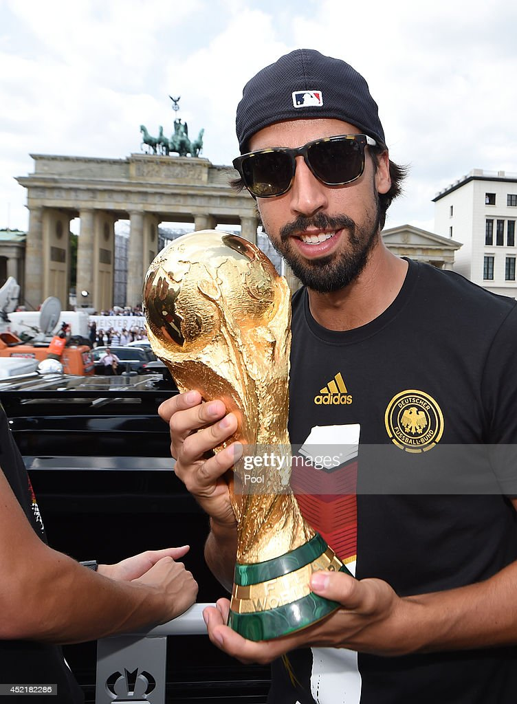 <a gi-track='captionPersonalityLinkClicked' href=/galleries/search?phrase=Sami+Khedira&family=editorial&specificpeople=2513712 ng-click='$event.stopPropagation()'>Sami Khedira</a> celebrates on the open top bus at the German team victory ceremony on July 15, 2014 in Berlin, Germany. Germany won the 2014 FIFA World Cup Brazil match against Argentina in Rio de Janeiro on July 13.