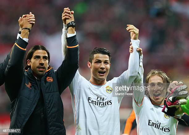 Sami Khedira Cristiano Ronaldo and Luka Modric of Real Madrid celebrate victory after the UEFA Champions League semifinal second leg match between FC...