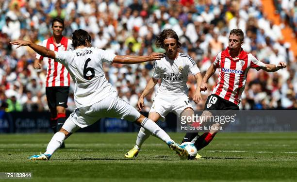 Sami Khedira Luka Modric of Real Madrid and Iker Muniain of Athletic Club Bilbao competes fot the ball during the La Liga match between Real Madrid...