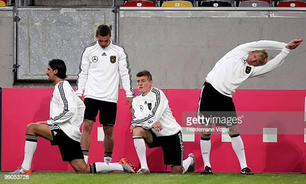 Sami Khedira Lukas Podolski Toni Kroos and Andreas Beck warm up during a German National team training session at the Esprit Arena on May 12 2010 in...