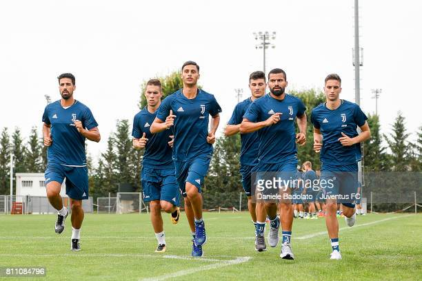 Sami Khedira Marko Pjaca Rolando Mandragora Riccardo Orsolini Tomas Rincon Rodrigo Bentancur of Juventus during a training session on July 9 2017 in...