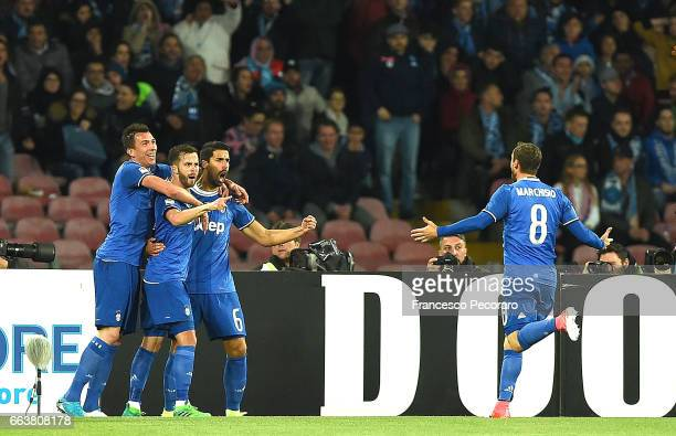 Sami Khedira Miralem Pjanic and Mario Mandzukic of Juventus FC celebrate the 01 goal scored by Sami Khedira during the Serie A match between SSC...