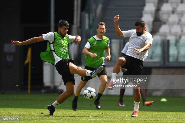 Sami Khedira of FC Juventus competes with Tomas Rincon of FC Juventus during the FC Juventus Media Day at Juventus Stadium di Torino on May 29 2017...