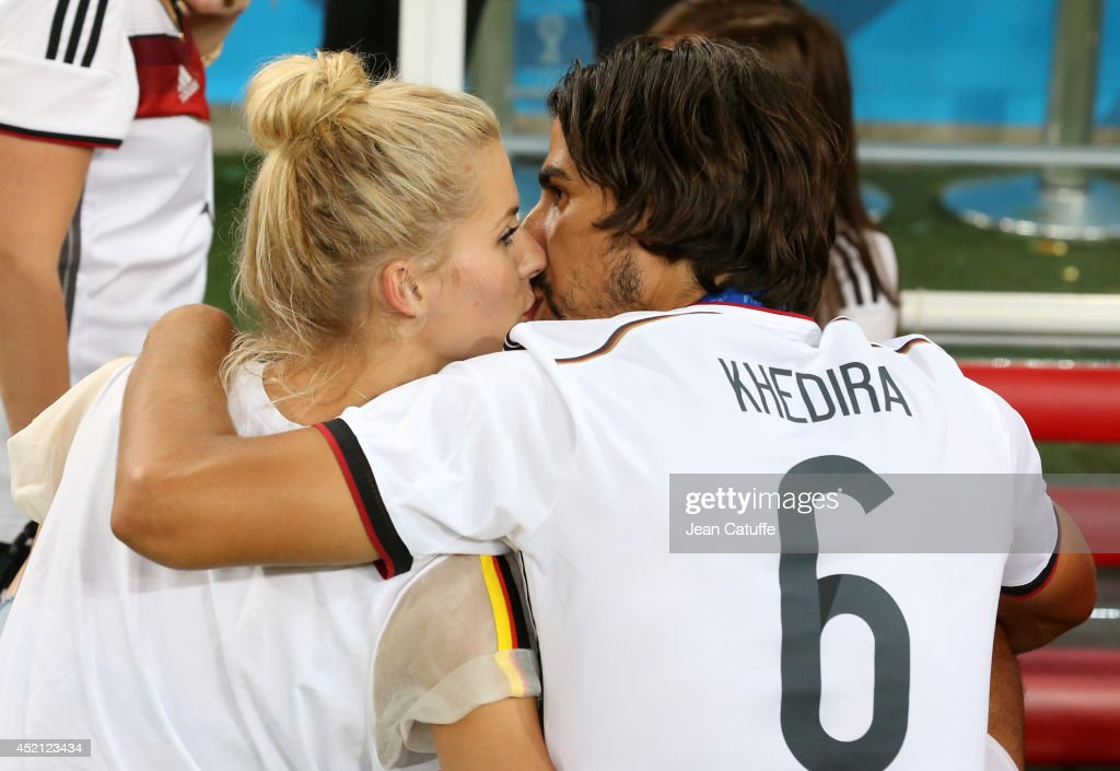 <a gi-track='captionPersonalityLinkClicked' href=/galleries/search?phrase=Sami+Khedira&family=editorial&specificpeople=2513712 ng-click='$event.stopPropagation()'>Sami Khedira</a> of Germany and his girlfriend <a gi-track='captionPersonalityLinkClicked' href=/galleries/search?phrase=Lena+Gercke&family=editorial&specificpeople=579958 ng-click='$event.stopPropagation()'>Lena Gercke</a> celebrate the victory after the 2014 FIFA World Cup Brazil Final match between Germany and Argentina at Estadio Maracana on July 13, 2014 in Rio de Janeiro, Brazil.