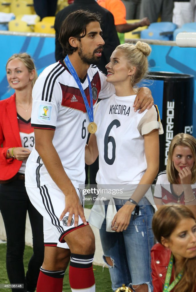 Sami Khedira of Germany and his girlfriend Lena Gercke celebrate the victory after the 2014 FIFA World Cup Brazil Final match between Germany and Argentina at Estadio Maracana on July 13, 2014 in Rio de Janeiro, Brazil.