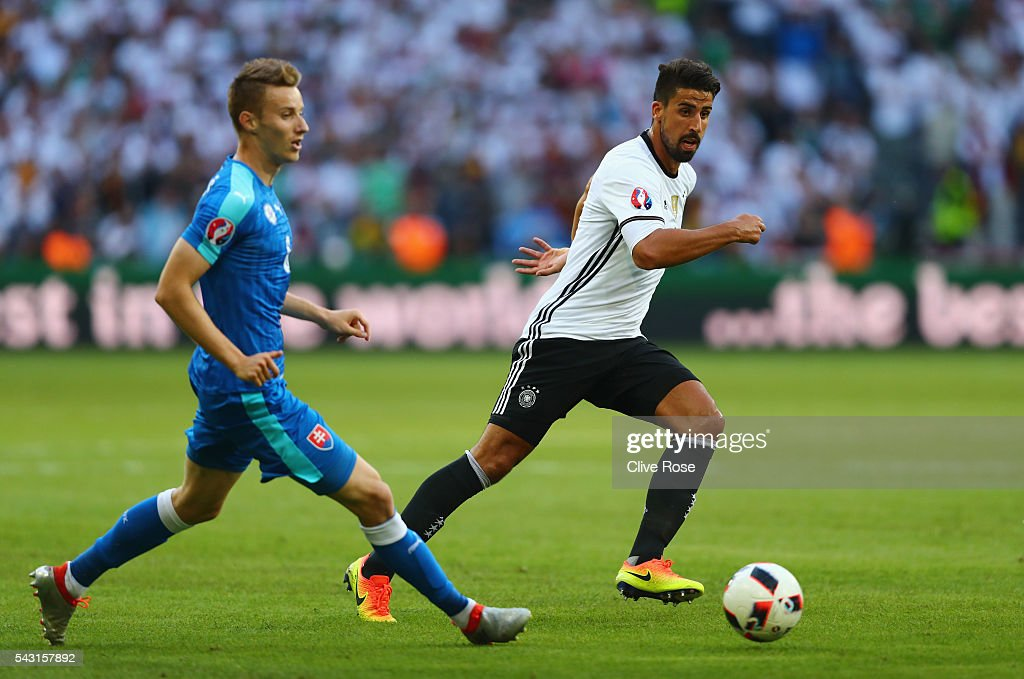 Sami Khedira of Germany and Jan Gregua of Slovakia compete for the ball during the UEFA EURO 2016 round of 16 match between Germany and Slovakia at Stade Pierre-Mauroy on June 26, 2016 in Lille, France.