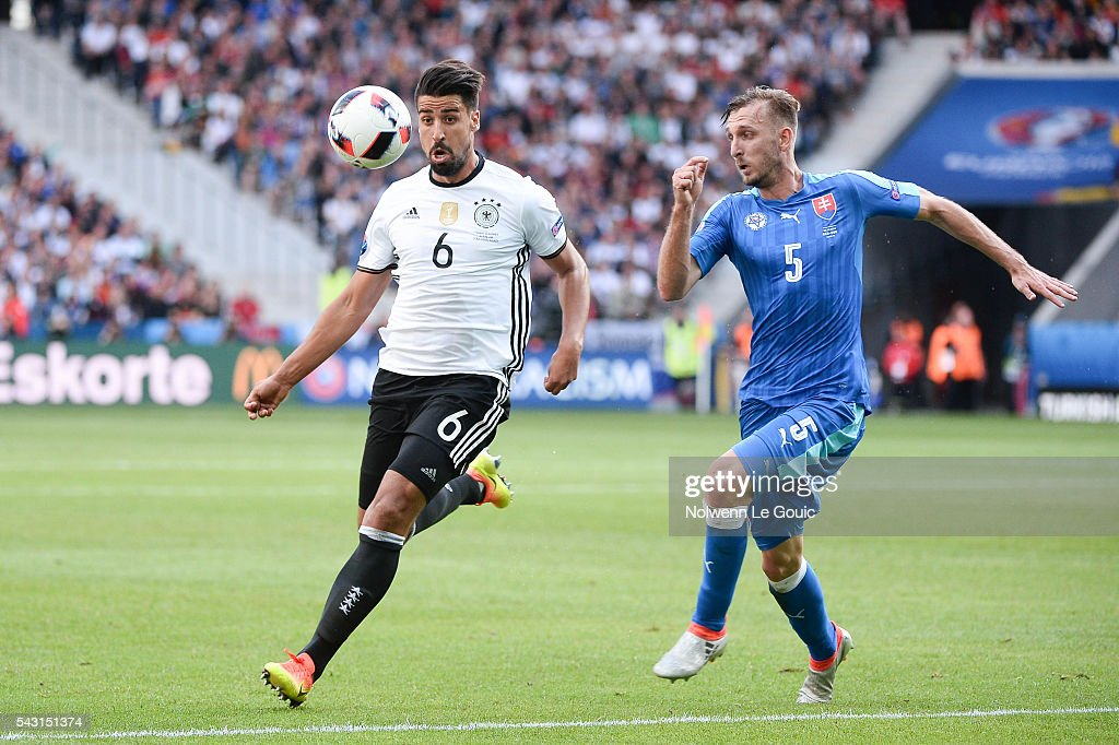 Sami Khedira of Germany and Norbert Gyomber of Slovakia during the European Championship match Round of 16 between Germany and Slovakia at Stade Pierre-Mauroy on June 26, 2016 in Lille, France.