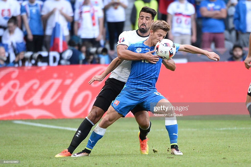 Sami Khedira of Germany and Patrik Hrosovsky of Slovakia during the European Championship match Round of 16 between Germany and Slovakia at Stade Pierre-Mauroy on June 26, 2016 in Lille, France.