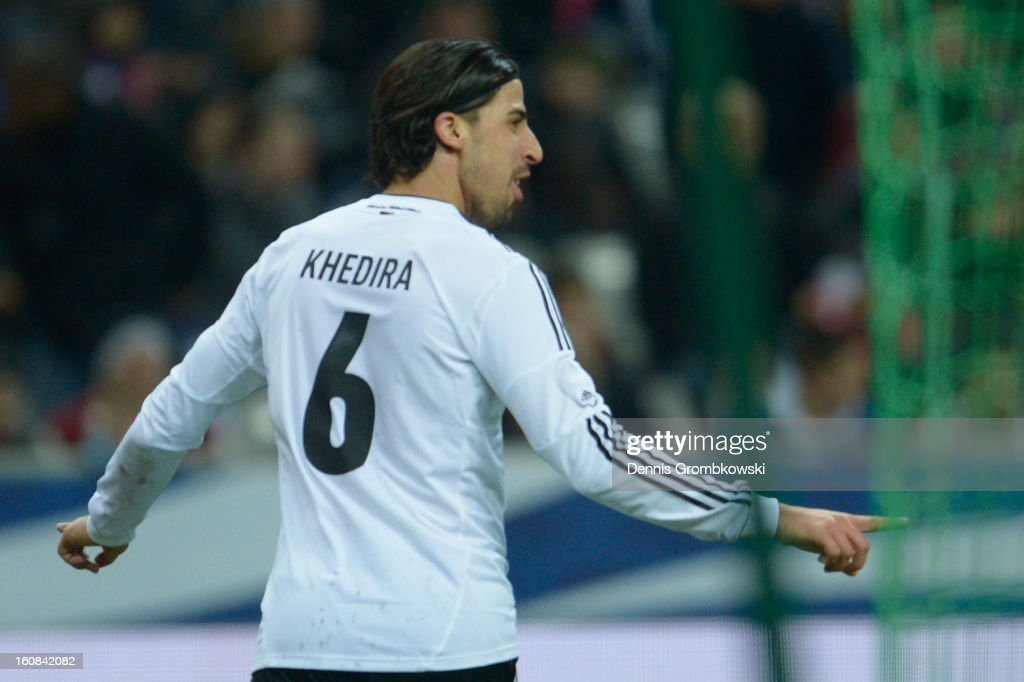 <a gi-track='captionPersonalityLinkClicked' href=/galleries/search?phrase=Sami+Khedira&family=editorial&specificpeople=2513712 ng-click='$event.stopPropagation()'>Sami Khedira</a> of Germany celebrates after scoring his team's second goal during the international friendly match between France and Germany at Stade de France on February 6, 2013 in Paris, France.