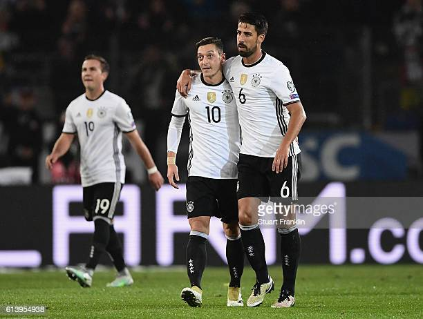 Sami Khedira of Germany celebrates scoring his sides second goal with Mesut Oezil of Germany during the FIFA 2018 World Cup Qualifier between Germany...