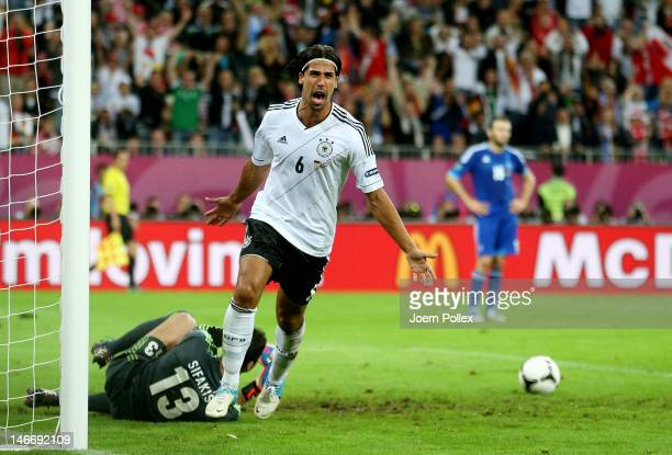 Sami Khedira of Germany celebrates scoring their second goal during the UEFA EURO 2012 quarter final match between Germany and Greece at The...