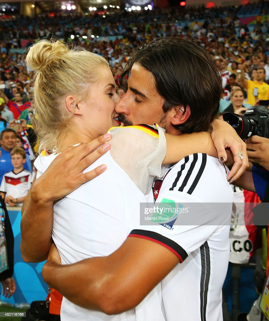 <a gi-track='captionPersonalityLinkClicked' href=/galleries/search?phrase=Sami+Khedira&family=editorial&specificpeople=2513712 ng-click='$event.stopPropagation()'>Sami Khedira</a> of Germany celebrates with girlfriend <a gi-track='captionPersonalityLinkClicked' href=/galleries/search?phrase=Lena+Gercke&family=editorial&specificpeople=579958 ng-click='$event.stopPropagation()'>Lena Gercke</a> after defeating Argentina 1-0 in extra time during the 2014 FIFA World Cup Brazil Final match between Germany and Argentina at Maracana on July 13, 2014 in Rio de Janeiro, Brazil.