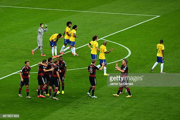 Sami Khedira of Germany celebrates with his teammates after scoring their fifth goal during the 2014 FIFA World Cup Brazil Semi Final match between...