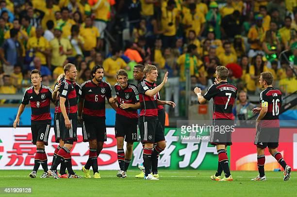 Sami Khedira of Germany celebrates wth his teammates Mesut Oezil Benedikt Hoewedes Thomas Mueller Jerome Boateng Toni Kroos Bastian Schweinsteiger...