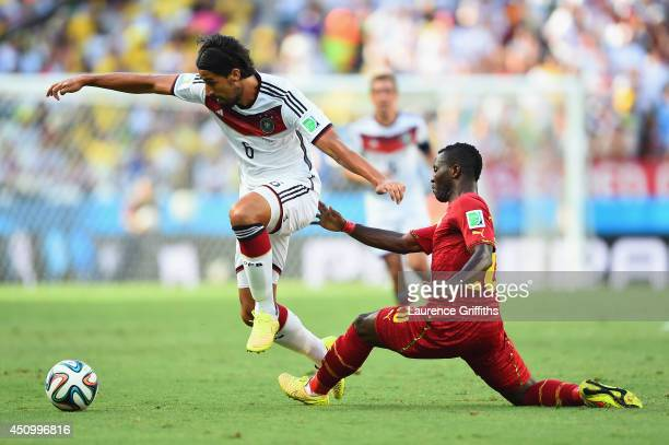 Sami Khedira of Germany controls the ball against Kwadwo Asamoah of Ghana during the 2014 FIFA World Cup Brazil Group G match between Germany and...