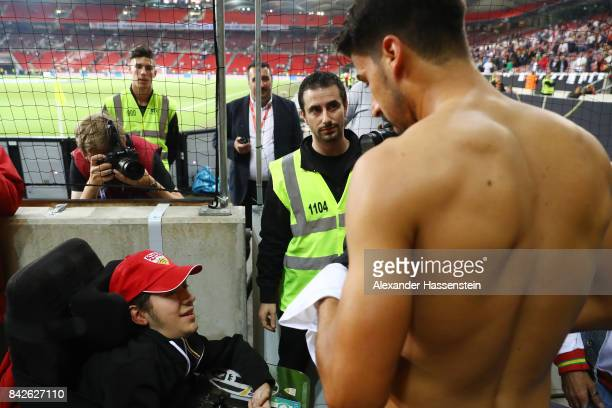 Sami Khedira of Germany gives his shirt to a disabled fan after the FIFA 2018 World Cup Qualifier between Germany and Norway at MercedesBenz Arena on...