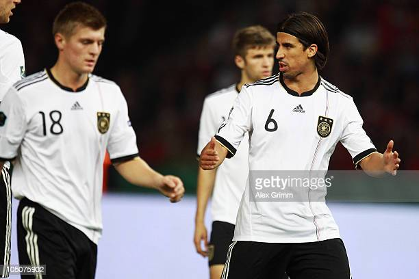 Sami Khedira of Germany gives instructions to team mate Toni Kroos during the EURO 2012 group A qualifier match between Germany and Turkey at the...
