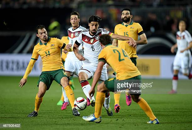 Sami Khedira of Germany is challenged by James Troisi of Australia during the International Friendly match between Germany and Australia at...