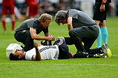 Sami Khedira of Germany is treated during the International Friendly match between Germany and Hungary at VeltinsArena on June 4 2016 in...