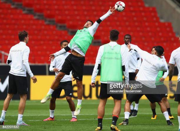 Sami Khedira of Germany jumps for the ball during a Germany training session at MercedesBenzArena ahead of their FIFA World Cup Russia 2018 Group C...