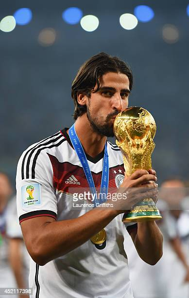 Sami Khedira of Germany kisses the World Cup trophy after defeating Argentina 10 in extratime during the 2014 FIFA World Cup Brazil Final match...