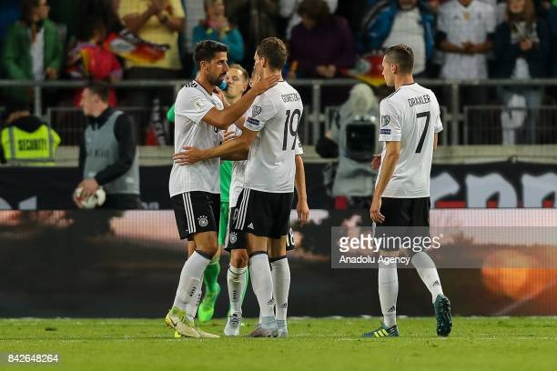 Sami Khedira of Germany Leon Goretzka of Germany Julian Draxler of Germany embrace after the FIFA 2018 World Cup Qualifier between Germany and Norway...