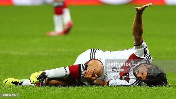 Sami Khedira of Germany lies injured on the pitch during the International Friendly match between Italy and Germany at San Siro Stadium on November...