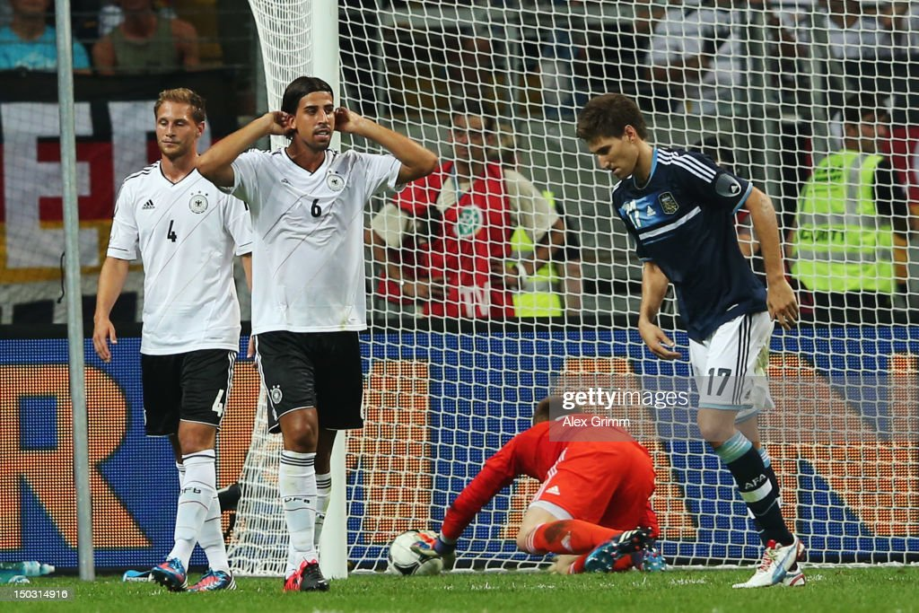 Sami Khedira (2L) of Germany reacts after scoring an own goal against goalkeeper Marc-Andre ter Stegen during the international friendly match between Germany and Argentina at Commerzbank-Arena on August 15, 2012 in Frankfurt am Main, Germany.