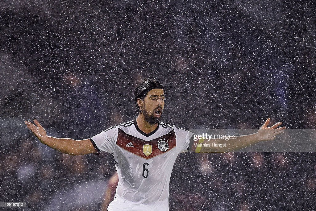 Sami Khedira of Germany reacts in the rain during the International Friendly match between Spain and Germany at Estadio Balaidos on November 18 2014...