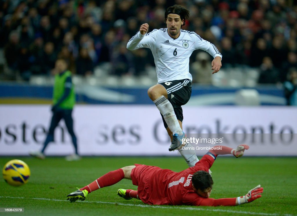 <a gi-track='captionPersonalityLinkClicked' href=/galleries/search?phrase=Sami+Khedira&family=editorial&specificpeople=2513712 ng-click='$event.stopPropagation()'>Sami Khedira</a> of Germany scores his team's second goal during the international friendly match between France and Germany at Stade de France on February 6, 2013 in Paris, France.