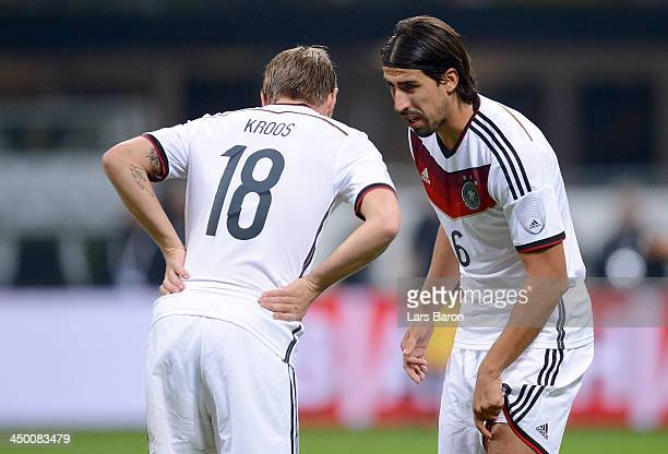 Sami Khedira of Germany speaks with Toni Kroos during the International Friendly match between Italy and Germany at San Siro Stadium on November 15...