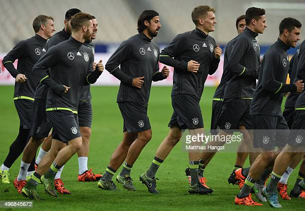 Sami Khedira of Germany warms up during a Germany training session ahead of their International Friendly against France at Stade de France on...