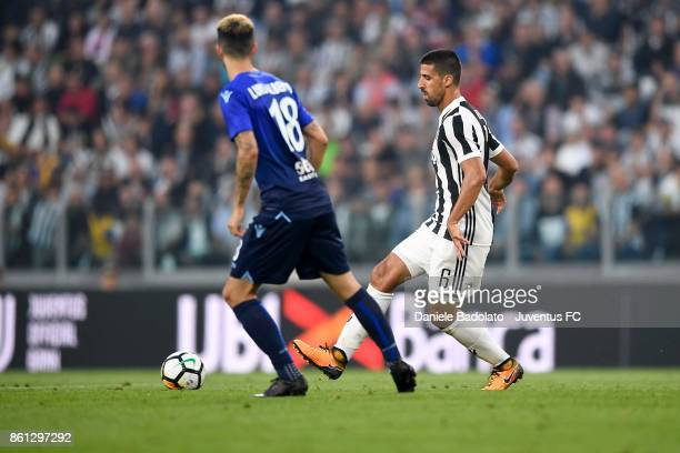 Sami Khedira of Juventus and Luis Alberto of Lazio competes for the ball during the Serie A match between Juventus and SS Lazio on October 14 2017 in...