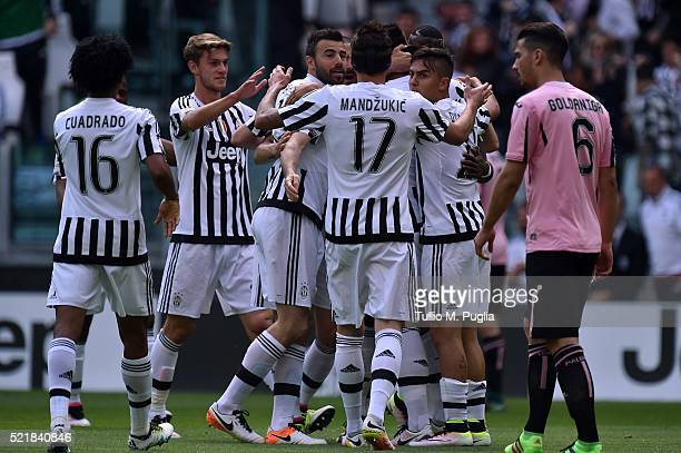 Sami Khedira of Juventus celebrates with his teammates after scoring the opening goal during the Serie A match between Juventus FC and US Citta di...