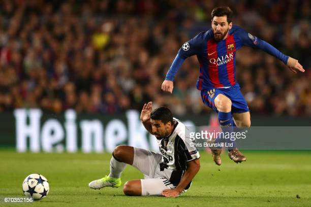 Sami Khedira of Juventus challenges Lionel Messi of FC Barcelona looks on during the UEFA Champions League Quarter Final second leg match between FC...