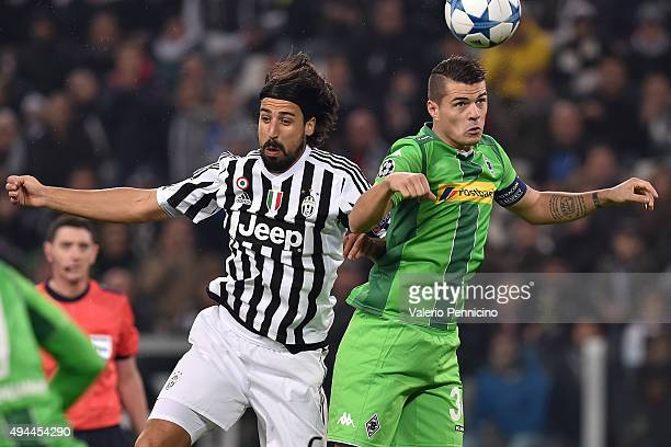 Sami Khedira of Juventus clashes with Granit Xhaka of VfL Borussia Moenchengladbach during the UEFA Champions League group stage match between...