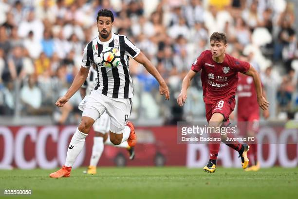 Sami Khedira of Juventus competes for the ball with Luca Cigarini of Cagliari during the Serie A match between Juventus and Cagliari Calcio at...