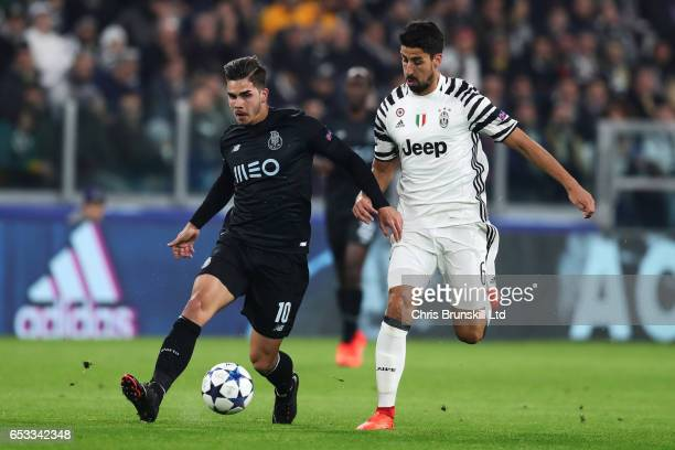 Sami Khedira of Juventus competes with Andre SIlva of FC Porto during the UEFA Champions League Round of 16 second leg match between Juventus and FC...