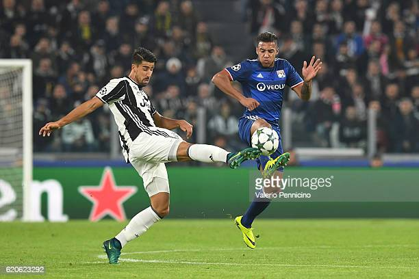 Sami Khedira of Juventus competes with Corentin Tolisso of Olympique Lyonnais during the UEFA Champions League Group H match between Juventus and...