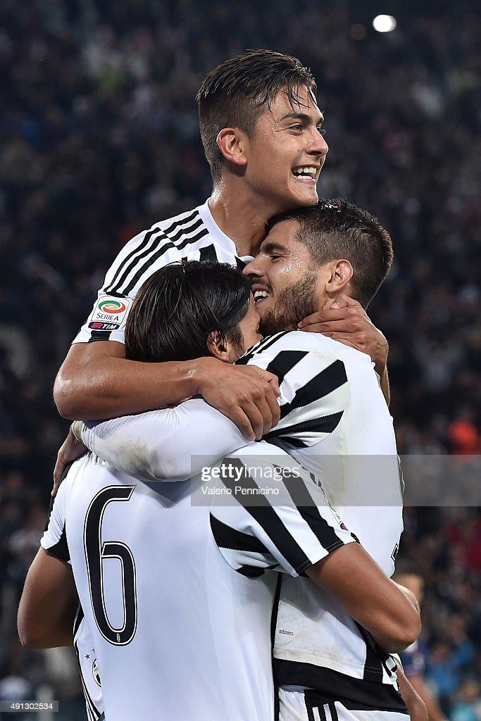 Sami Khedira of Juventus FC celebrates a goal with team mate Alvaro Morata and Paulo Dybala during the Serie A match between Juventus FC and Bologna...
