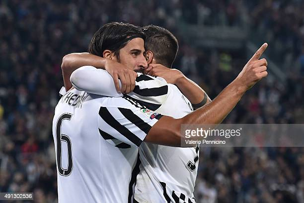 Sami Khedira of Juventus FC celebrates a goal with team mate Alvaro Morata during the Serie A match between Juventus FC and Bologna FC at Juventus...