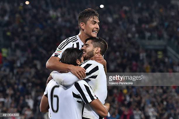 Sami Khedira of Juventus FC celebrates a goal with team mate Alvaro Morata and Paulo Dybala during the Serie A match between Juventus FC and Bologna...