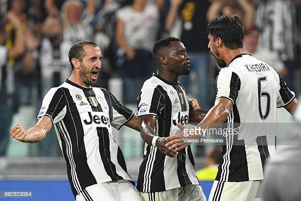 Sami Khedira of Juventus FC celebrates after scoring the opening goal with team mates Giorgio Chiellini and Kwadwo Asamoah during the Serie A match...