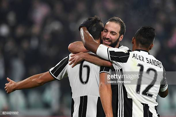 Sami Khedira of Juventus FC celebrates after scoring the opening goal with team mates Gonzalo Higuain and Alex Sandro during the Serie A match...