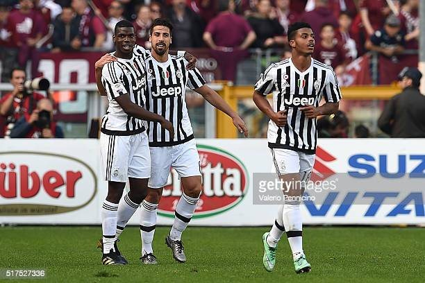 Sami Khedira of Juventus FC celebrates his goal with team mate Paul Pogba during the Serie A match between Torino FC and Juventus FC at Stadio...
