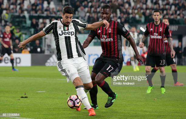 Sami Khedira of Juventus FC competes for the ball with Cristian Zapata of AC Milan during the Serie A match between Juventus FC and AC Milan at...