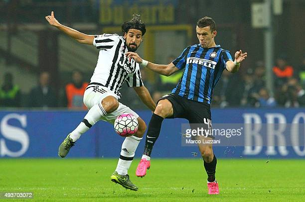 Sami Khedira of Juventus FC competes for the ball with Ivan Perisic FC Internazionale Milano during the Serie A match between FC Internazionale...