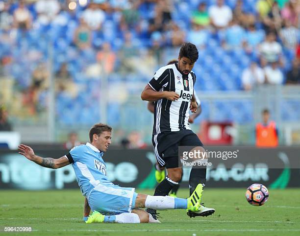 Sami Khedira of Juventus FC competes for the ball with Lucas Biglia of SS Lazio during the Serie A match between SS Lazio and Juventus FC at Stadio...
