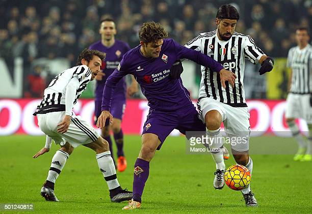 Sami Khedira of Juventus FC competes for the ball with Marcos Alonso of ACF Fiorentina during the Serie A match betweeen Juventus FC and ACF...
